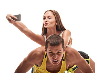 man doing push ups and woman fun with selfie