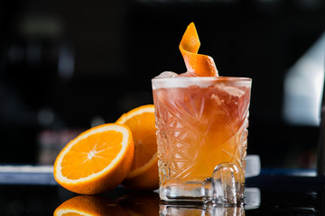 Fresh cocktail with orange and ice. Alcoholic, non-alcoholic dri