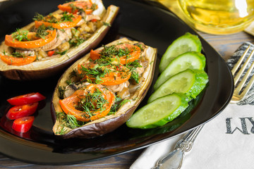 Eggplant stuffed with fresh mushrooms, tomatoes with dill