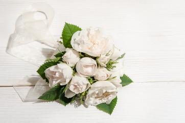 white roses on white table.top view