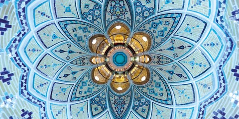 Beautiful mathematical geometric turquoise colored decoration of the brick ceiling and walls at a traditional Middle East bath house in Kashan, central Iran - wide angle view