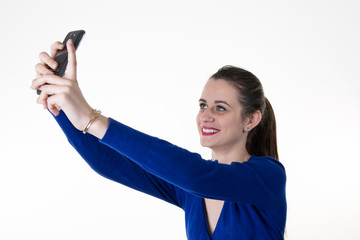 Smiling businesswoman making selfie photo on smartphone.