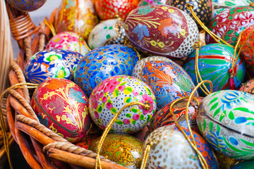 Background with many colorful painted Easter eggs in basket at the traditional European market
