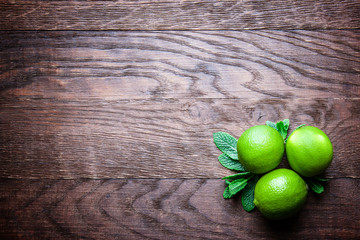 limes on a wooden background