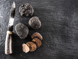 Black truffles on the graphite board.