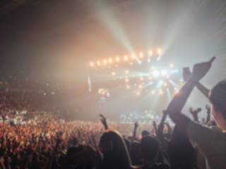 Blurred background : Bokeh lighting in indoor concert with cheering audience