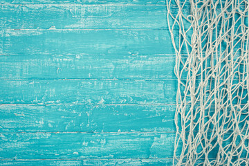 Fishing net from right side of turquoise board