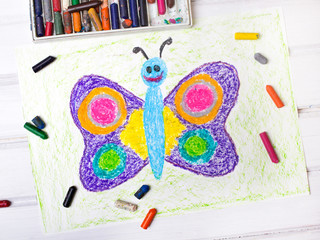 closeup of a drawing: happy butterfly with colorful wings