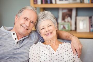 Portrait of senior couple sitting on sofa
