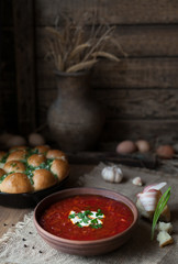 Traditional Ukrainian or Russian borscht with sour cream and garlic. Vegetarian vegetable food.