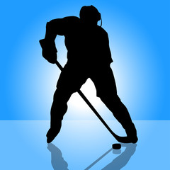 Hockey player attacks silhouette background.