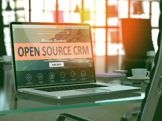 Modern Workplace with Laptop showing Landing Page with Open Source CRM - Customer Relationship Management - Concept. Toned Image with Selective Focus. 3D Render.