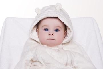 portrait of a cute baby in white hood bear