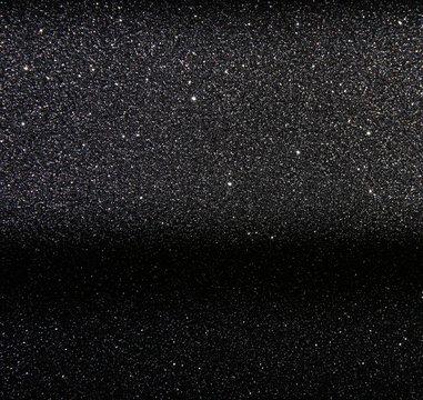 glitter vintage lights background. silver and black. defocused.