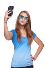 Woman in sunglasses tropical resort reflection making selfie with smartphone