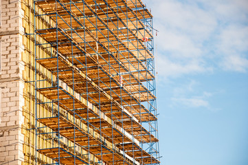 Scaffolding elements in a construction site.