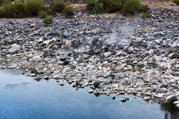 hot spring in the mountain river