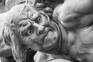 Detail of a public fountain in Vienna, Austria. The baroque statue is showing the desperation of a defeated person.