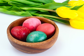 Painted Easter Eggs and Spring Yellow Tulips Flower