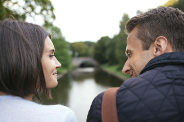 Young couple faces sloseup looking and smiling