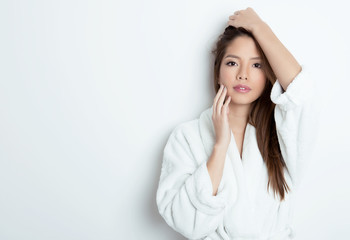 beautiful young asian woman with flawless skin and long hair