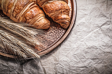 Golden wheat rye ears croissants brass tray food and drink conce