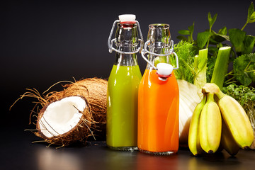 Glasses with fresh vegetable juices isolated on black. Detox