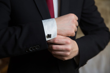 businessman wearing cufflinks