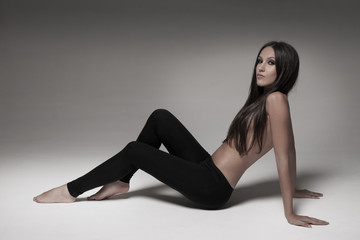 Sexy brunette woman wearing black leggings