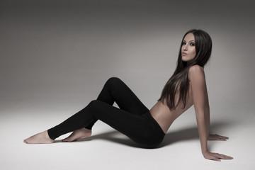Sexy brunette woman wearing black leggings