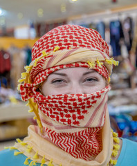 Girl of Slavic appearance wearing a headscarf Arab