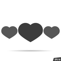 Three gray hearts with shadow on a white background