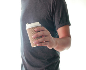 A man is holding a paper cup