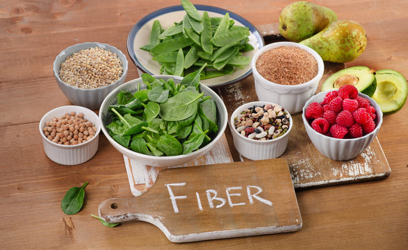 Foods rich in Fiber on a wooden table.