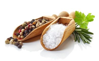 Salt and pepper on white background