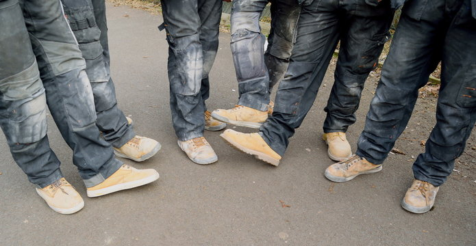 Group of real construction workers wearing safety shoes