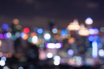 Abstract blurred bokeh lights city skyline during twilight
