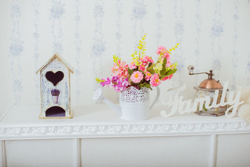 Home decor spring. Grinder and a vase of spring flowers in the style Shabby chic. White label family