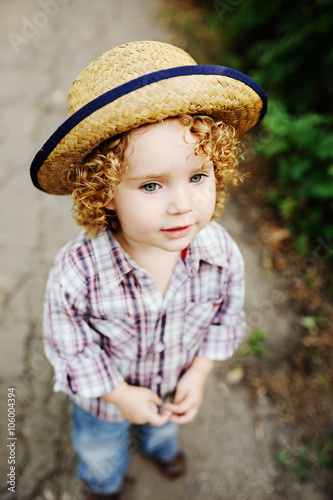 01bd54bfb portrait of curly red-haired baby in a hat. Cute baby girl cowbo ...