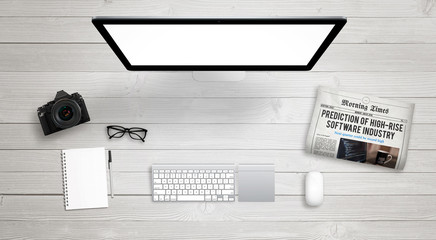 Isolated computer display for mockup on work desk with keyboard, mouse, newspaper, coffee, camera, notebook, glasses, pencil.