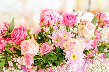 wedding bouquet with rose bush, Ranunculus asiaticus as a backgr