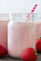 Delicious strawberry smoothie on rustic wood