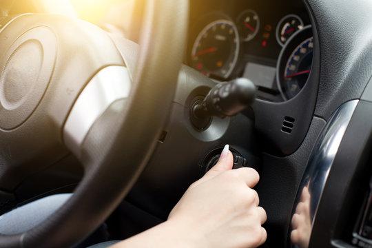 Woman starting car