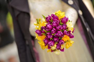 Bridal bouquet made of yellow and purple tulips