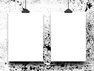 Close-up of two hanged blank frames with clips against black and white abstract art background