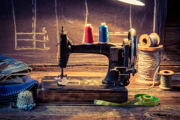 Vintage tailor workshop with sewing machine, cloth and scissors