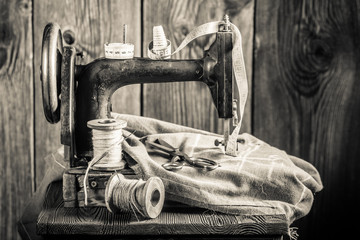 Vintage sewing machine with needle, threads and tailor tape