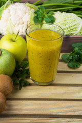 Green fresh smoothie with fruits and vegetables
