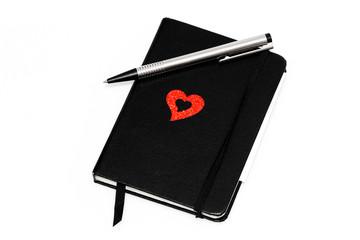 Notizbuch mit Herzsymbol