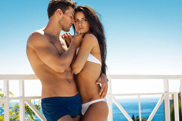 Sexy couple touching at each other outdoor in summer scenery